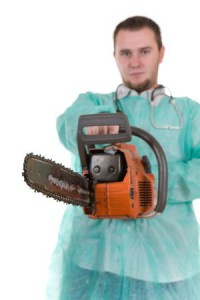 3829284 - bad doctor isolated on white background with diesel saw